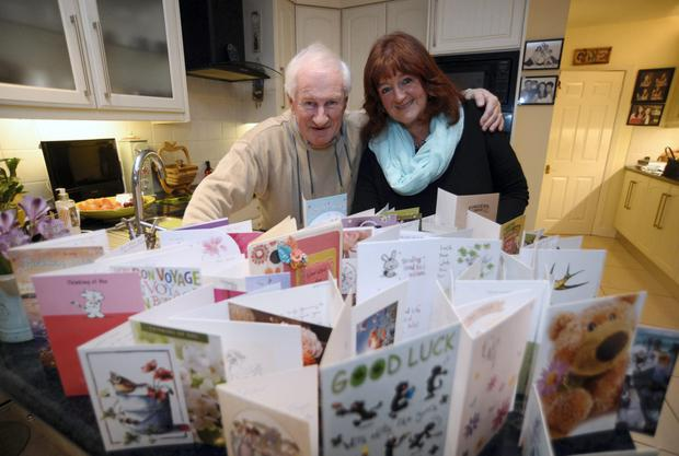 Ann Brennan and her husband Seamus with all her 'good luck' cards, at their home in Killiney, Dublin.