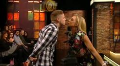 Katie Hopkins kisses an audience member on the Late Late