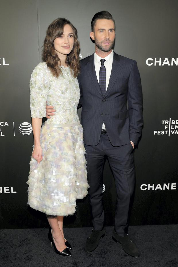 Actress Keira Knightley (L) and musician Adam Levine