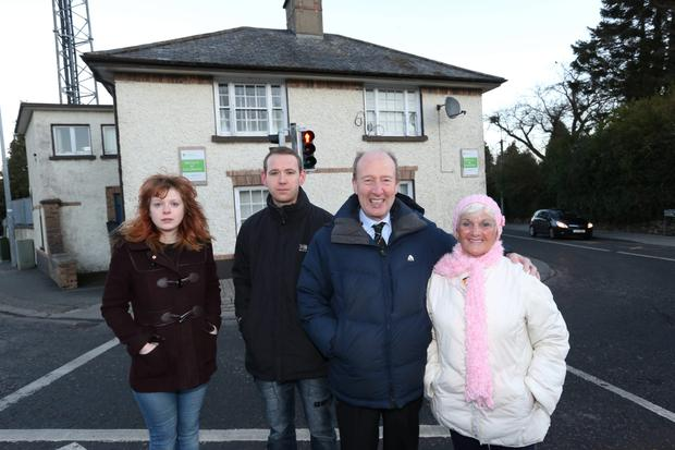 Shane Ross TD pictured with Stepaside Residents who have been burgaled (from left); Laura Byrne, Brendan Mitchell and Mary Doyle, at the former Stepaside Garda Station