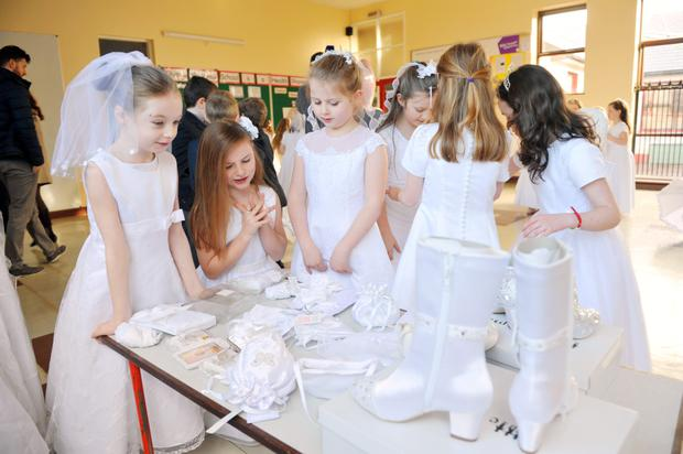 Schoolchildren from Ovens National School, Cork pictured modelling dresses and accessories donated to Cork Penny Dinners Charity for their First Holy Communion Appeal