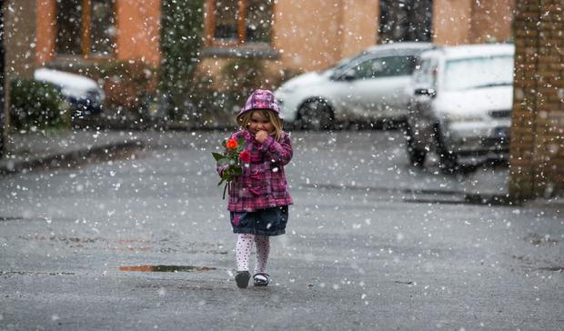 A young girl makes her way home with flowers to her mother in North Dublin.