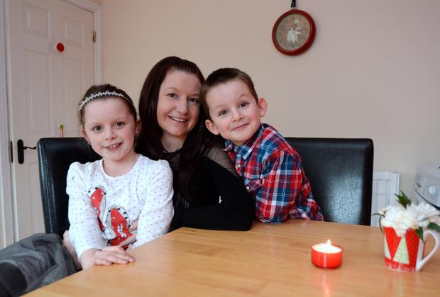 Natasha Darcy with her children Niamh, 8, and Oisin, 6. Leopardstown, Dublin. Picture: Caroline Quinn