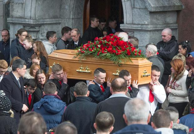 The remains of Eric Stanton who died tragically in Glanmire, Co. Cork, are carried from St Joseph's Church, Mayfield followed by his family.
