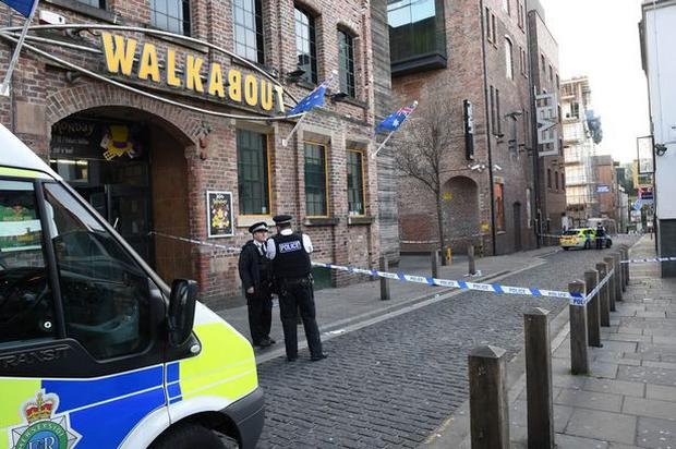 The police outside the Walkabout bar in Liverpool bar