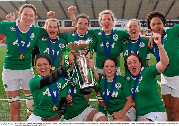 Ireland players celebrate with the Women's Six Nations Rugby Championship trophy. Women's Six Nations Rugby Championship,