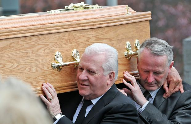 Ronan Collins carries the coffin of his mother, Ethna at St. Peter's Church, Phibsboro