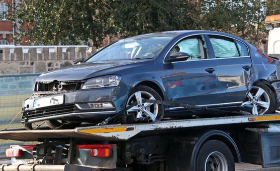 One of the vehicles involved in the shooting are removed from the scene of a shooting on Church Avenue, Drumcondra