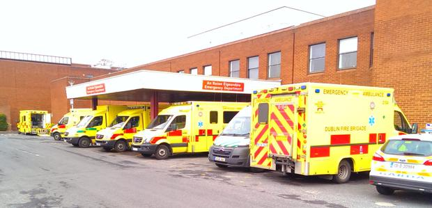 Five Dublin Fire Bridgae ambulances and one HSE ambulance wait at Beaumont Hospital for the return of their trolleys on the morning of Monday 30/3/2015 The ambulances were there for at least 2 hours