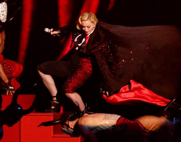 Madonna falling on stage while performing at this year's Brit Awards