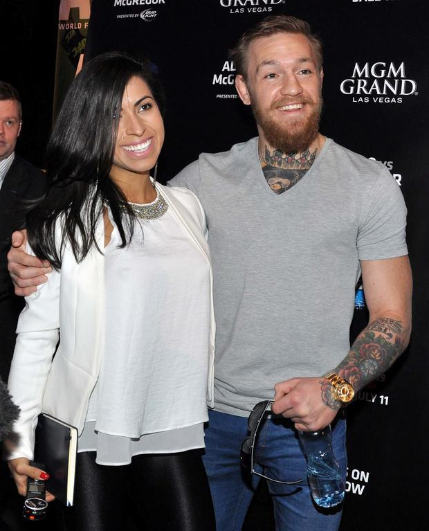 UFC fighters Conor McGregor with a Brazilian female fan Heloany Guimaraes.