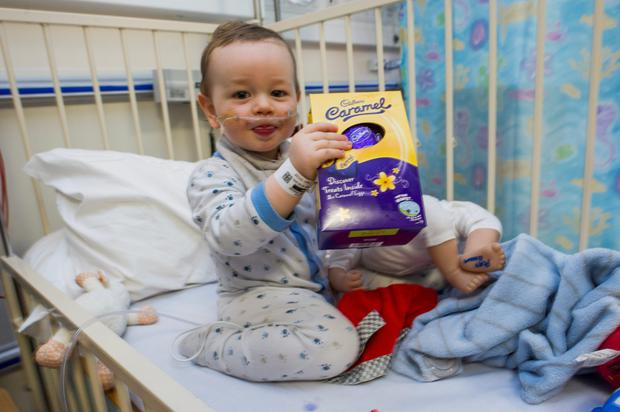 Oscar Leech (18 months) from Santry gets to grips with his Easter egg