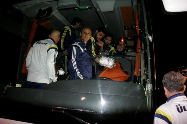 From R-L Fenerbahce's players Emre Belezoglu, Alper Potuk, Bekir Irtegun and Coach Ismail Kartal are seen in team bus which was shot while it has been driven through to Trabzon Airport in the Black Sea coastal province of Trabzon, northeastern Turkey late April 4, 2015