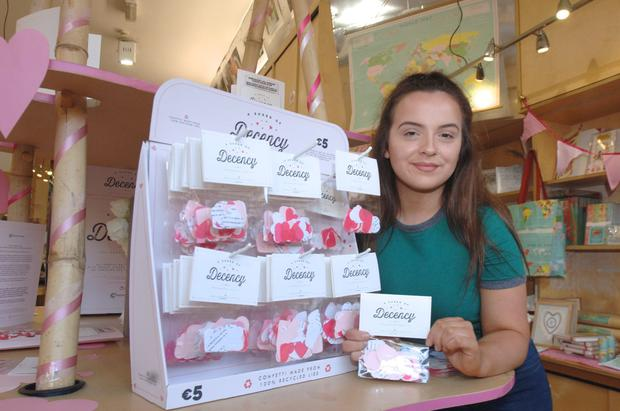 Daintree Paper shop assistant Roisin Farrel with some of the A Shred of Decency confetti
