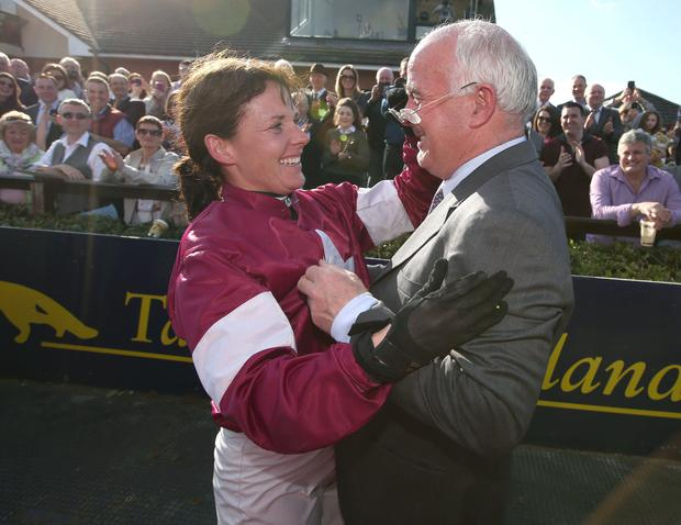 Katie Walsh, celebrates with her father, Ted