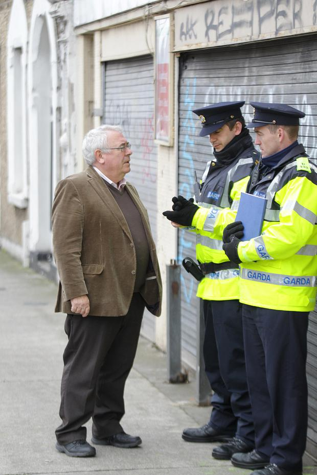 Joe Costello TD, Minister for Trade and Development, pictured as Garda preserve the scene on Phibsboro Road.