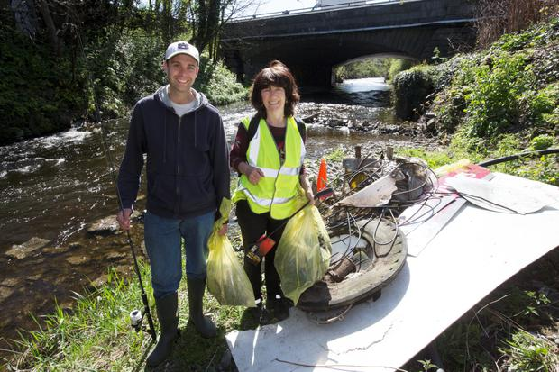 Dodder Action Volunteers, Cory Hanson and Victoria White pictured with a pile of rubbish cleaned from The Dodder River at Donnybrook today. Dodder Day, a clean up day on The Dodder River takes place along its banks on Saturday 18th April.