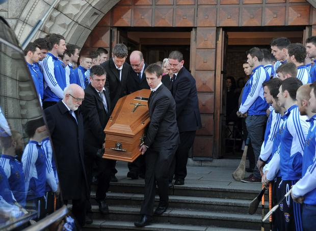Mourners at the funeral of Dublin legend Dave Billings