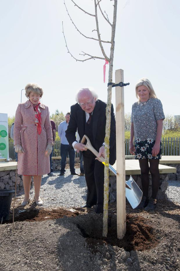 President Michael D Higgins and his wife Sabina pictured with Leon Kelly, Supervisor, TAP at the opening of the garden at Finglas yesterday.