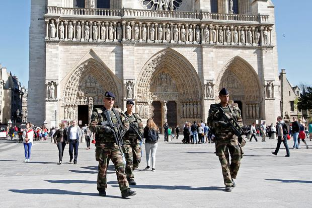 French soldiers patrol outside the Notre Dame Cathedral as part of the
