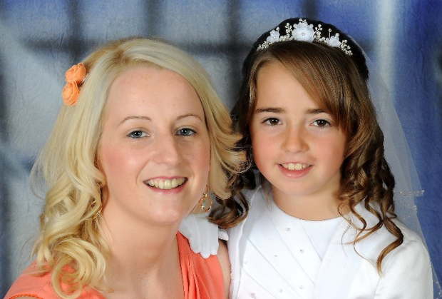 Zoe Scannell (8) in her communion dress, with her mum Elisha Scannell.