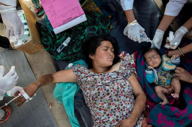 Injured woman and her daughter receive medical treatment after arriving at Dhading hospital, in the aftermath of Saturday's earthquake, in Dhading Besi, Nepal