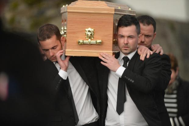 Karen's brothers carry her remains at her removal in Cork