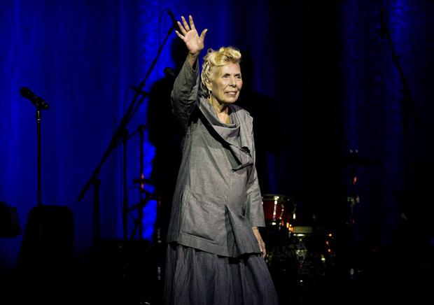 Joni Mitchell waves to the crowd during her 70th birthday tribute concert as part of the Luminato Festival at Massey Hall in Toronto