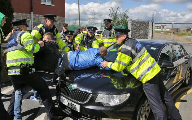 Gardai and Water charge protestors clash as Minister Alen Kelly attempts to leave pictured at the official opening of Grand Canal View by the Lord Mary Christy Burke and Alan Kelly TD, Minister for the Environment, Community and Local Government