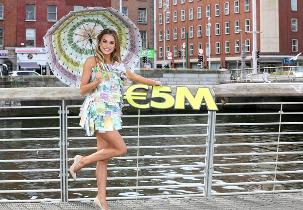 . Beautiful model Sinead Duffy looked a million dollars as she braced the unseasonably cool May weather to celebrate Saturday's high €5 million Lotto jackpot. Pic: Mac Innes
