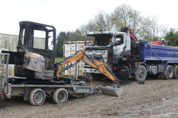 A mini digger and truck burned out in an attack in Waterford