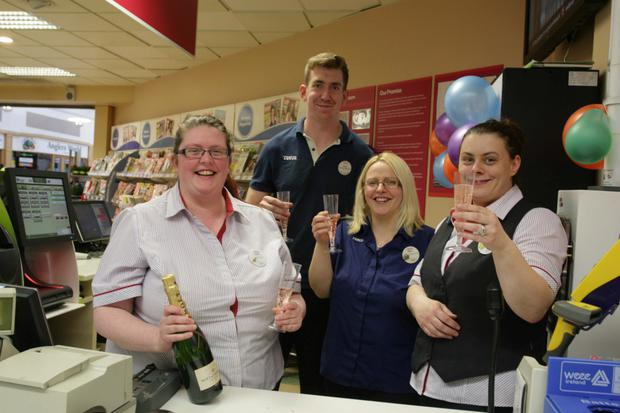 Tesco employees in Mullingar; Laura Donoghue, Sean O'Neill, Mary Maher and Sandra Morgan celebrating their store's winning numbers in the weekend National Lottery draw which will net the lucky winner(s) 5.9 million euro. Photo: David Walsh
