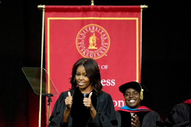 First lady Michelle Obama gives a thumbs up after walking out on stage just before deliveringthe commencement address at Tuskegee University