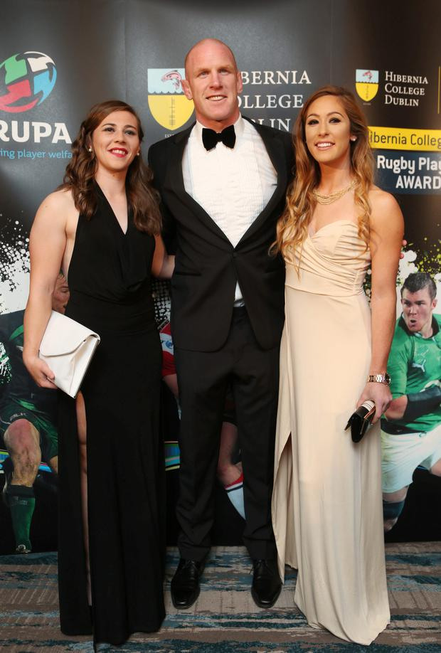 Paul O'Connell with members of the Female Irish Rugby team Eimear Considine and Katie Fizherny