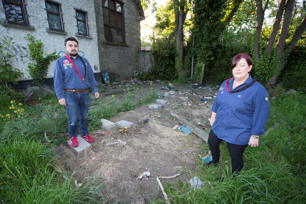 Achille Martone and Maria Tellgren, Scout Leaders at The 45th Mount Argus Scout Group pictured at the spot where their container with €30,000 worth of Scout Camping equipment was removed from, at their den last night.