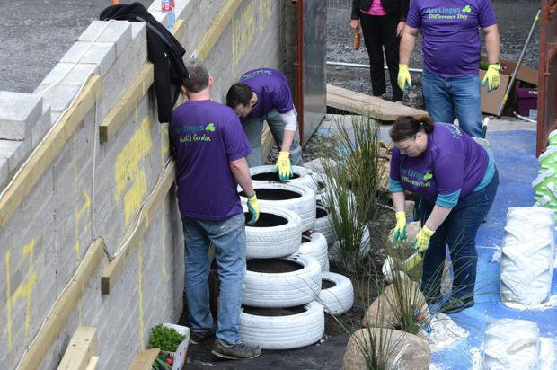 The team from Aer Lingus help get the building and gardens on Belvedere Place ready.
