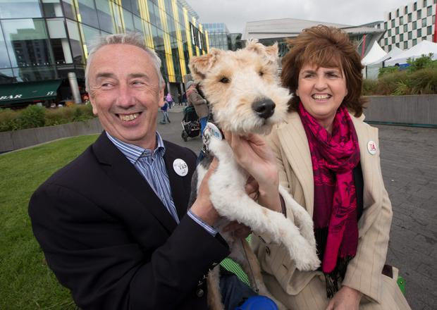 Tánaiste Joan Burton canvassing with Kevin Humphries TD and a dog Oscar, at the Docklands Festival Grand Canal as the Marriage Equality campaign enters its final week and encouraging people to vote Yes.