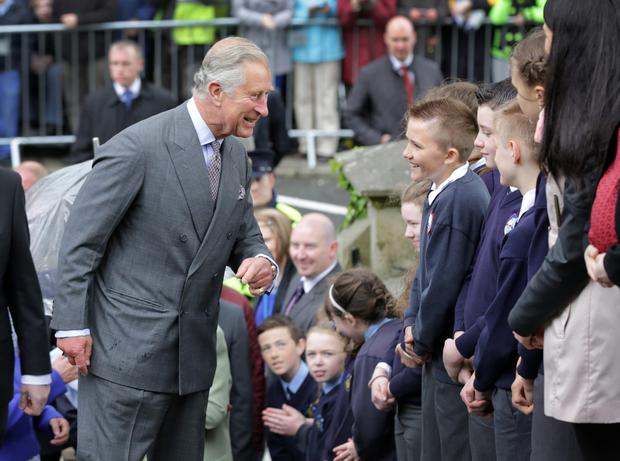 Prince Charles shares a laugh with some local school children as he arrived with the Duchess, at The Model Arts center in Sligo