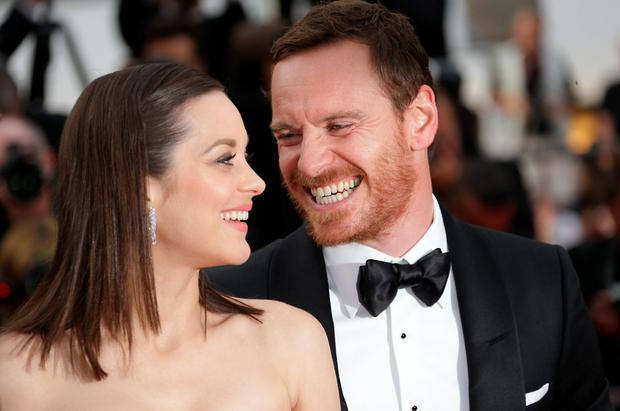 Cast members Marion Cotillard and Michael Fassbender pose on the red carpet as they arrive for the screening of the film