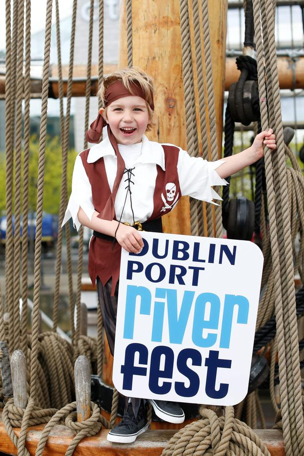 Pirate James Canavan (5) helps to launch RiverFest