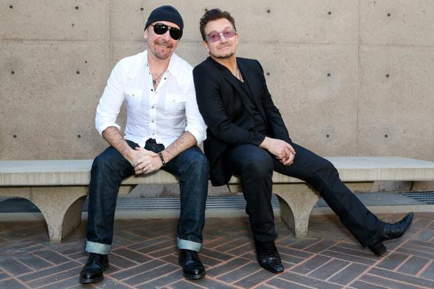 Musicians The Edge (L) and Bono attend the 25th annual Palm Springs Film Festival