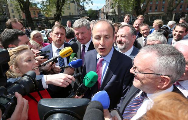 Fianna Fail leader, Micheal Martin with Newly elected Fianna Fáil TD for Carlow Kilkenny, Deputy Bobby Aylward (wearing purple tie) pictured arriving at Leinster House this afternoon with members of the Fianna Fail Party