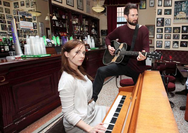 Tom Parsons and Megan Riordan at a jam session at Maureen's Bar in the Olympia Theatre to launch Once the musical