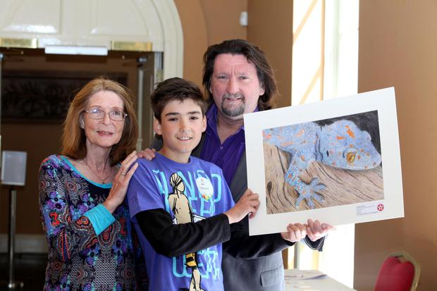Lochlan King with his painting 'Night Shift' is joined by his grandmother Joan King; who entered the very first Competition 61 years ago and his father Julian who entered in 1976 at the 61st Texaco Children's Art Competition Awards Ceremony in the Royal Hospital Kilmainham.