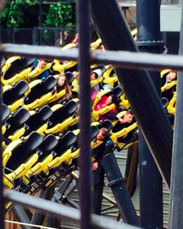 Photo taken with permission from the Twitter feed of @MfcJordan, of Alton Towers amusement park's Smiler rollercoaster, showing an injured passenger (centre right) after four people were seriously injured in a collision between two carriages.
