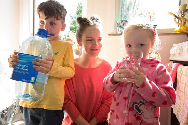 Christina Moran with her children Jack (5) and Molly (3) and their bottled water at their Raheny home