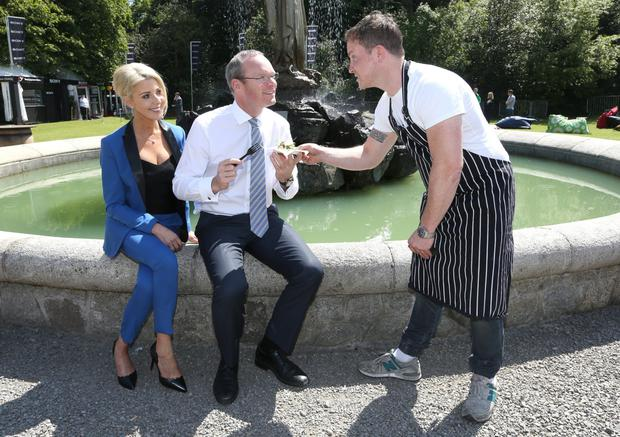 Simon Coveney, Minister for Agriculture with Avril Bannerton, MD of Taste of Ireland and Chef, Barry McNerney, at the opening of Taste of Dublin food Festival at the Iveagh Gardens, Dublin