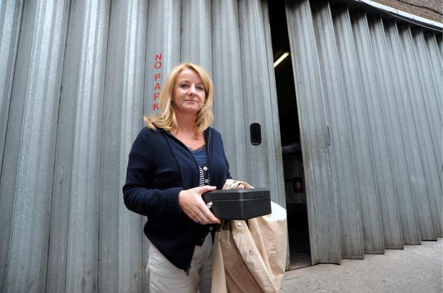 Sharen McCabe (owner of McCabe's Pharmacies) pictured with petty cash box after removing her stock from Clery's goods entrance