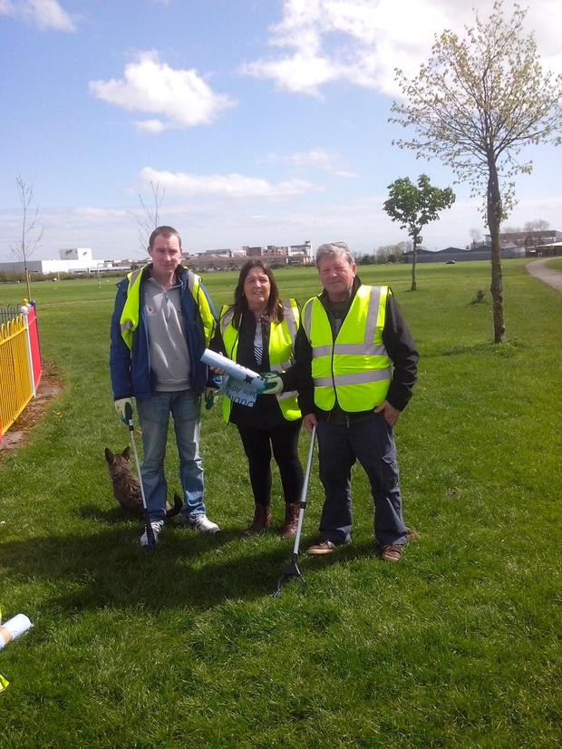 Volunteers from left to right: Derek Potter, Susan French, and Bill Malone at Darndale Park.