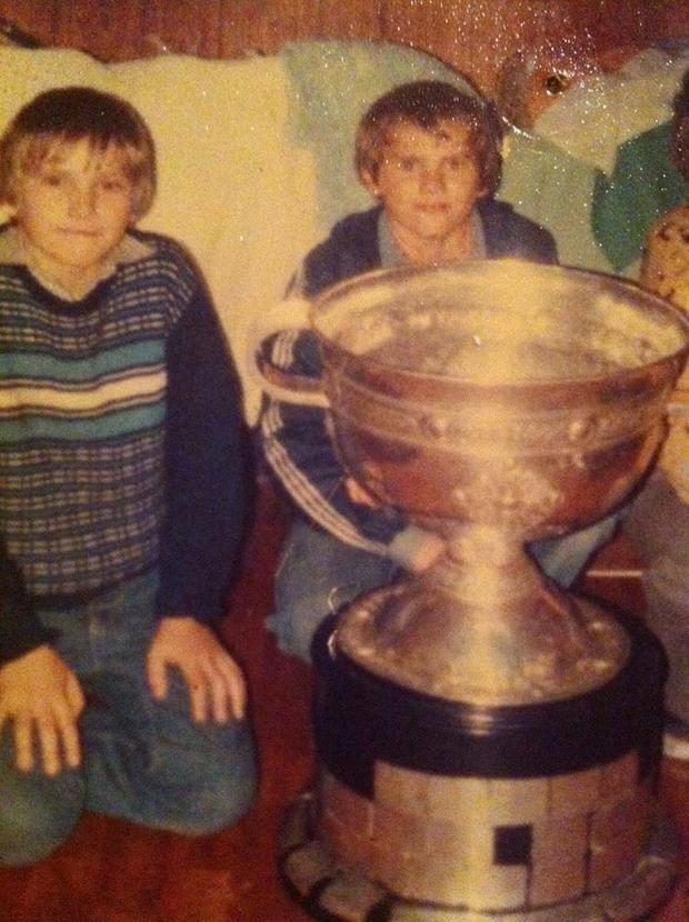 Darren Harris on left with Alan Harris behind the Sam Maguire Cup